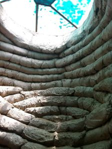here is an example of some of the bags that didn't get plastered over. these bags provide the structure and fill of the buildings and are held together with barbed wire. one line i especially liked today: the architect wanted to use the materials of war to create these homes.